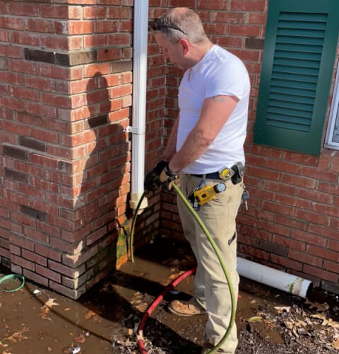Roto-rooter plumber service technician Eddie performing a sewer jetting service on a main line in Plainfield, NJ